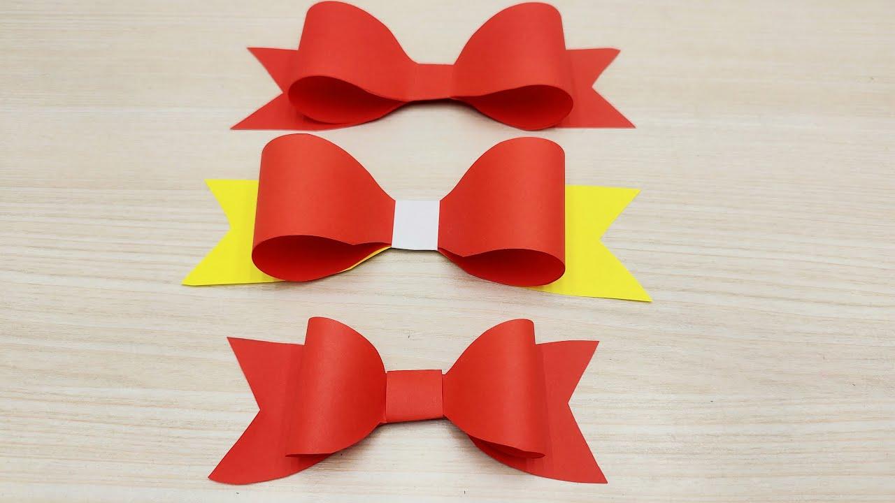 Как из бумаги сделать бантик. как сделать бумажный бантик. статья знакомит с вариантами оформления бантиков из бумаги.