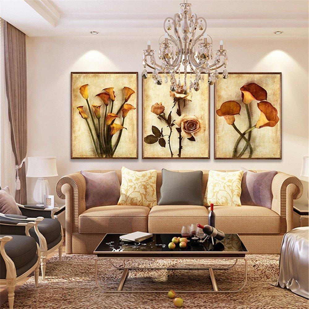Как развесить картины на стене красиво: принципы и варианты