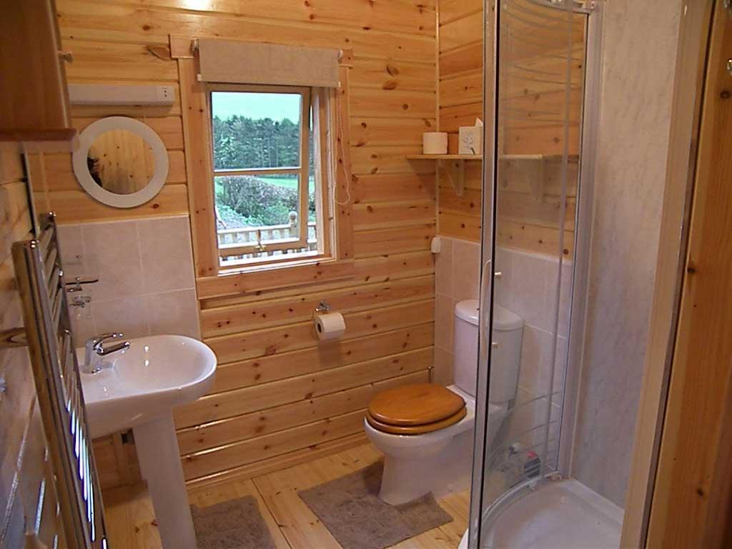 Санузел в деревянном доме: ремонт и финишная отделка